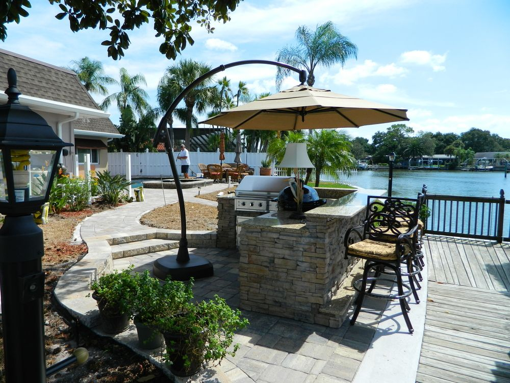 Outdoor Kitchens With Umbrella Shading Premier Outdoor Living Design Tampa Fl In 2020 Outdoor Kitchen Outdoor Living Design Outdoor Living