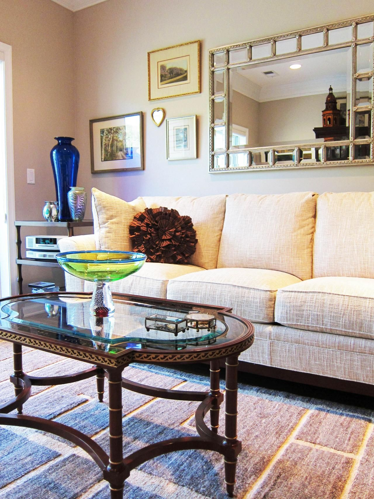 Heather McManus designed this white transitional living room A