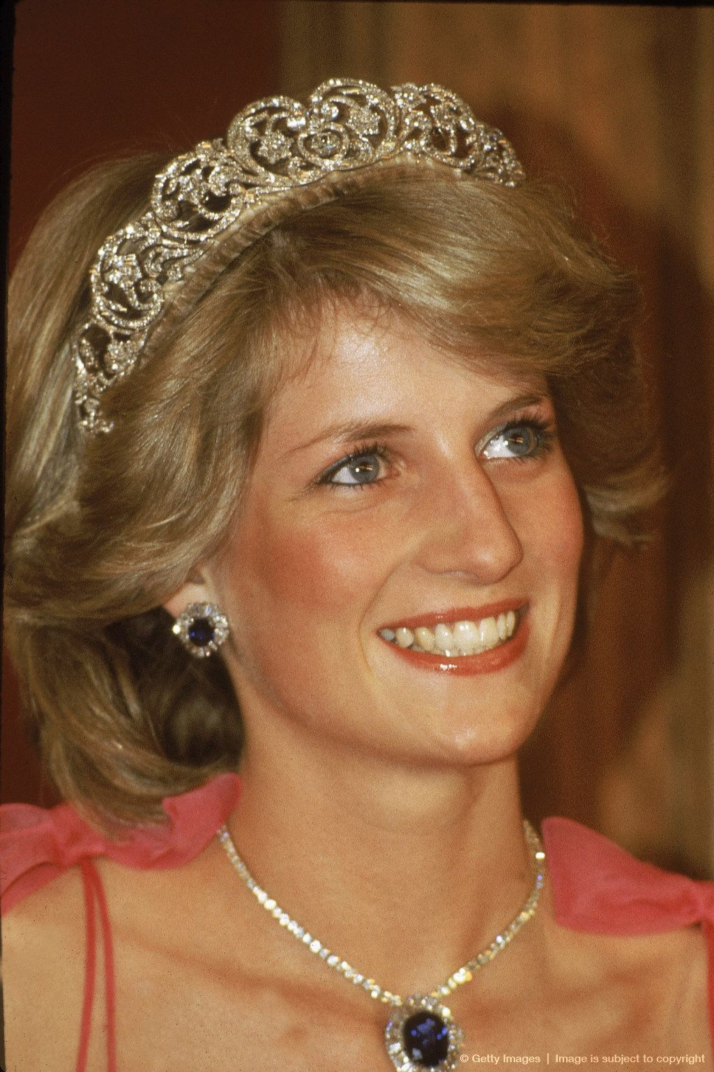 Image detail for -BRISBANE, AUSTRALIA - APRIL 11: Princess Diana wears the Spencer Family diamond Tiara, with a suite of sapphire and diamond jewellery - including a pendant & matching earrings - given as a gift by the Crown Prince of Saudi Arabia at a State Reception on April 11, 1983 in Brisbane, Australia.