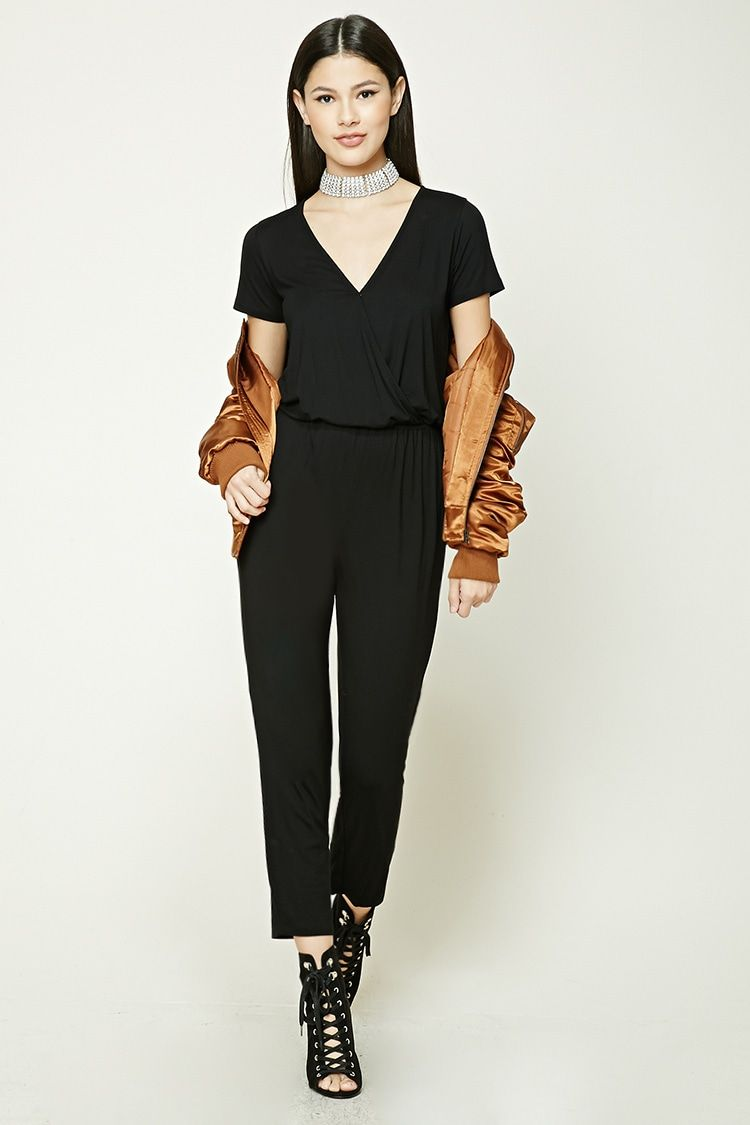 A midweight slub knit jumpsuit featuring a surplice neckline with a