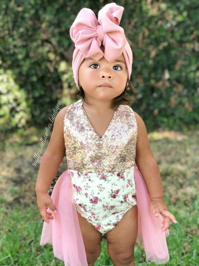 108ec307883 Our adorable Alexandra tutu Romper features a soft cream   dusty rose  floral print motif