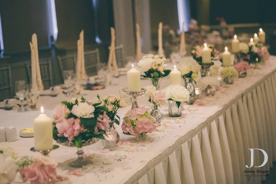 Top table flowers at The Mere - Silver mercury glass vases and pillar  candles - Flowers