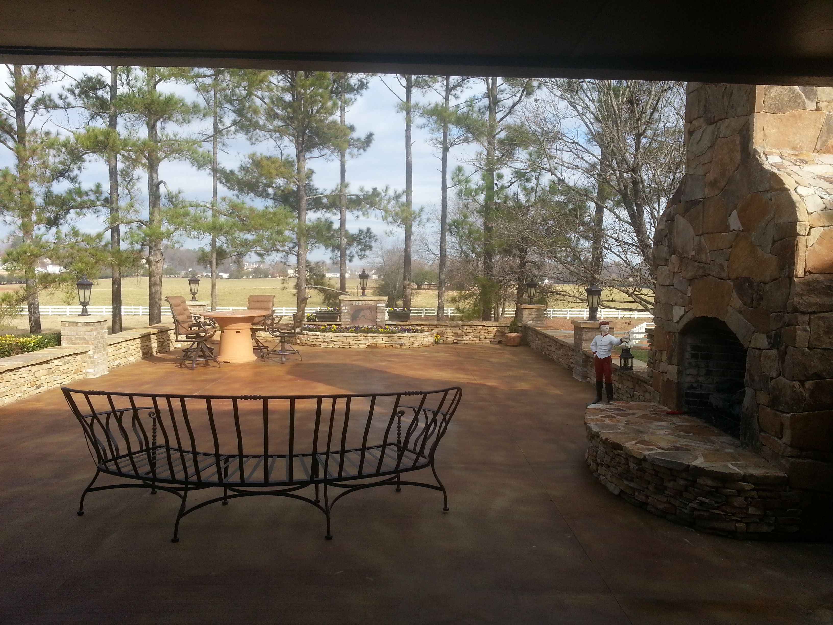 covered old swim pool and created outdoor patio and fireplace ...