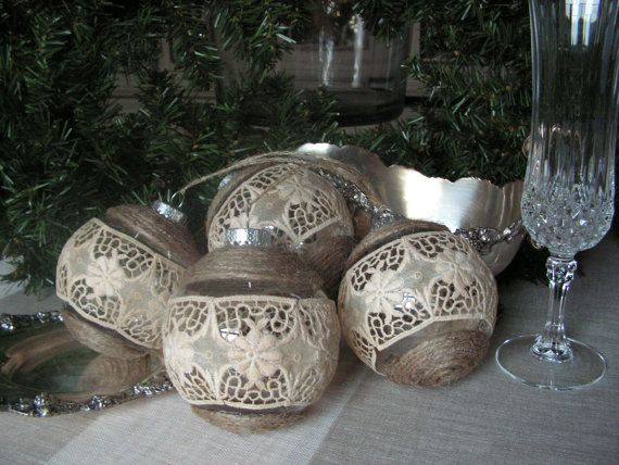 All Handmade Rustic christmas ornaments wrapped arround with old rope, and decorated with very old French cotton lace. A special and rare item. They look Rustic, little victorian but still decorated enough to catch someones eye...everything is made from recycled materials.