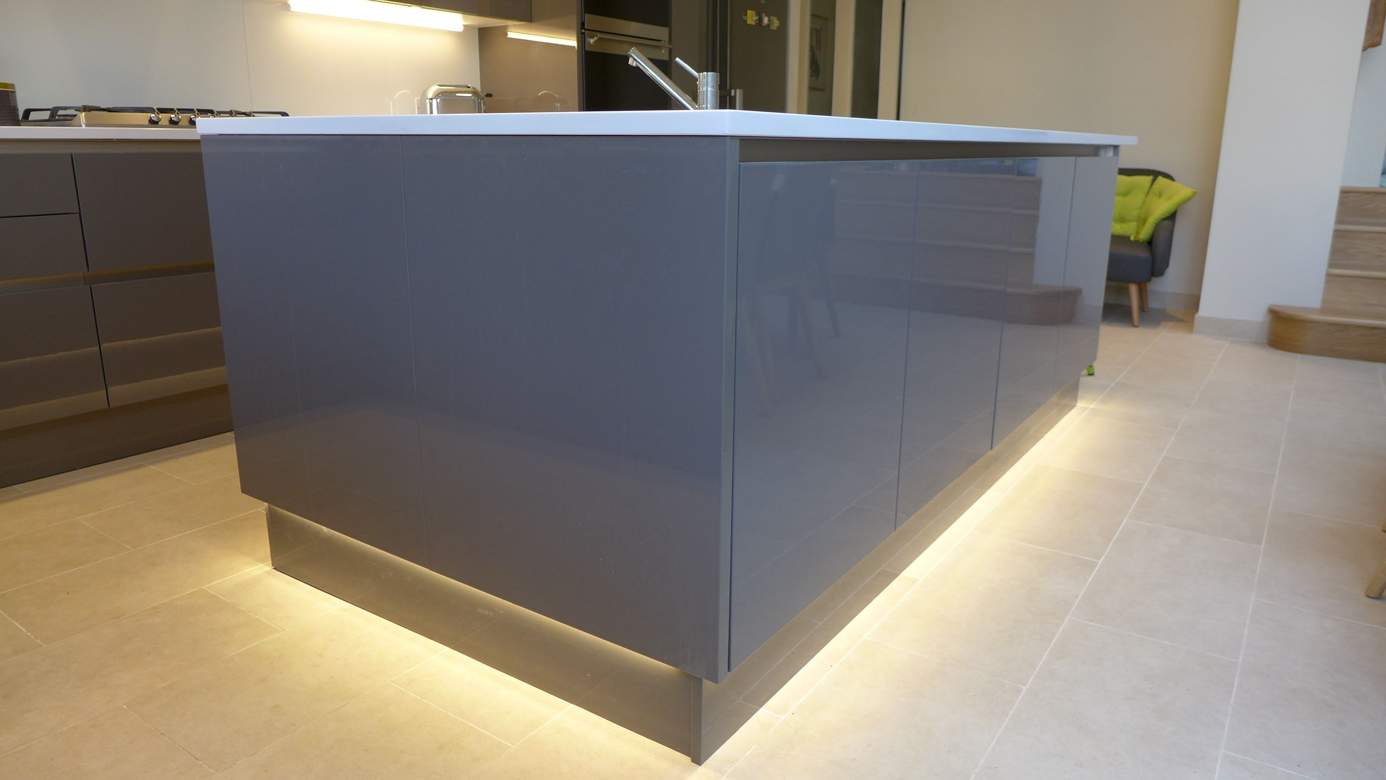 watch 6fdcb 856e7 LED strip lighting beneath plinth of kitchen island. Note ...