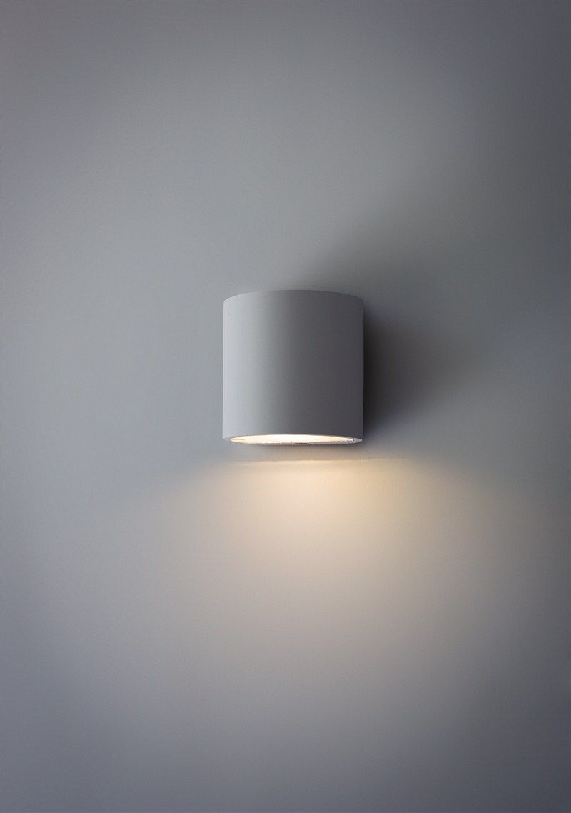 This troika plaster single wall lamp can be painted any colour you