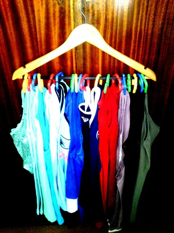 Organising tank tops on wooden hanger. You can use shower rail ...