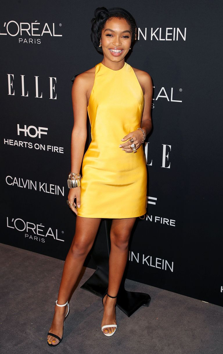 in a sunny yellow dress and black-and-white sandals at an Elle event in L.A. 97ec12ccd
