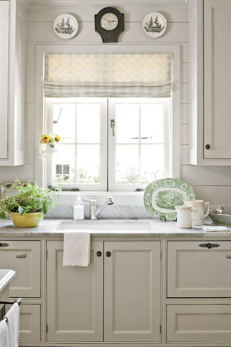 Above window decor  casement window over kitchen sink with roman shade window treatments