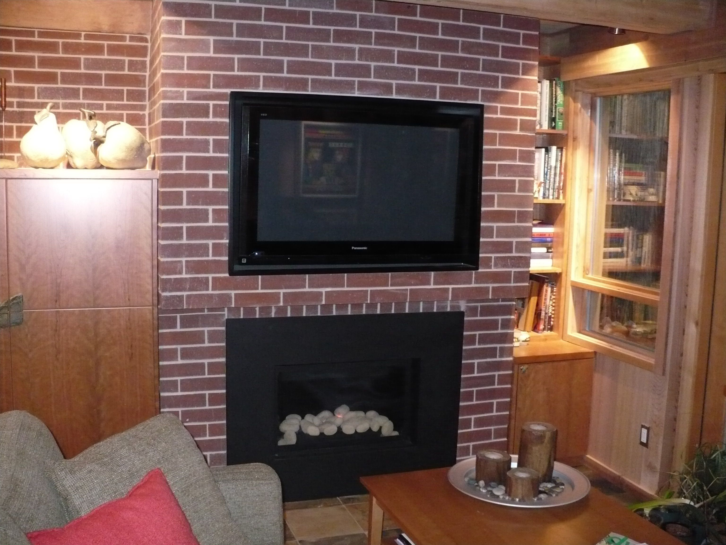 Living room gas brick fireplace new millwork crescent view