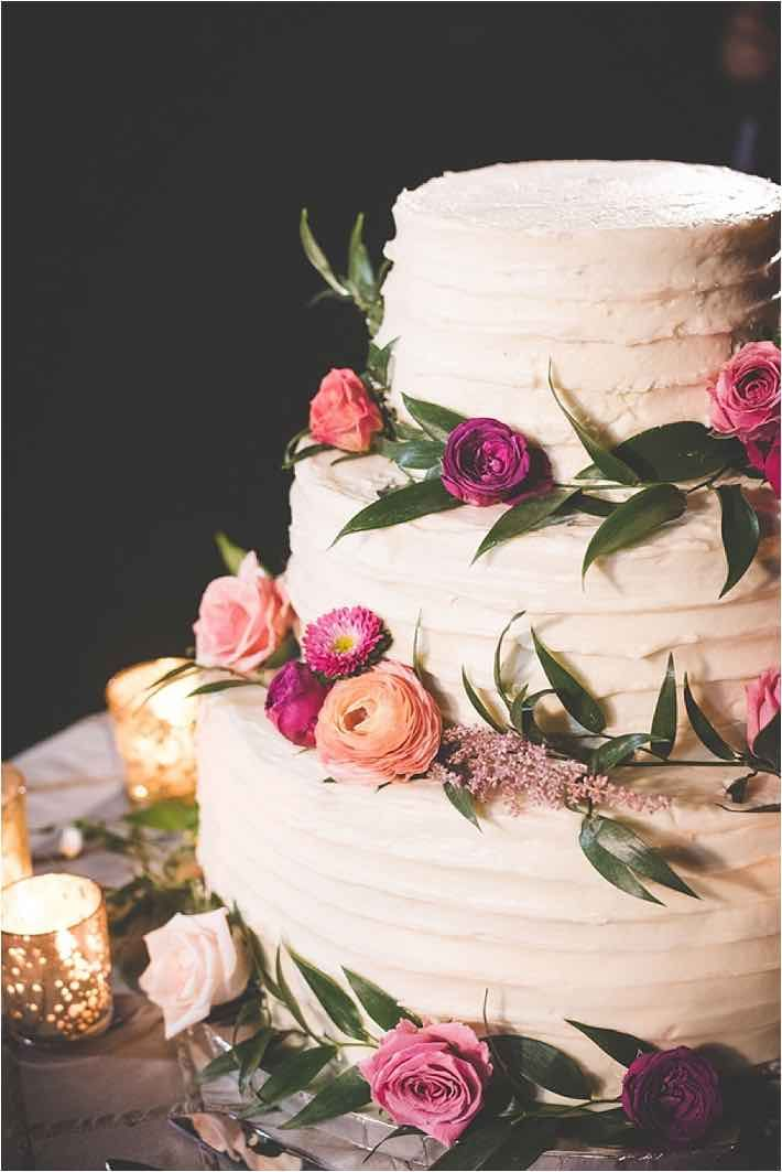 Buttercream With Greenery And Flowers Wedding Cake