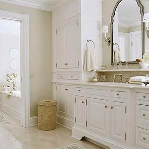 Traditional Bathroom Mirrors light beige floor tile and walls with white cabinets | floors