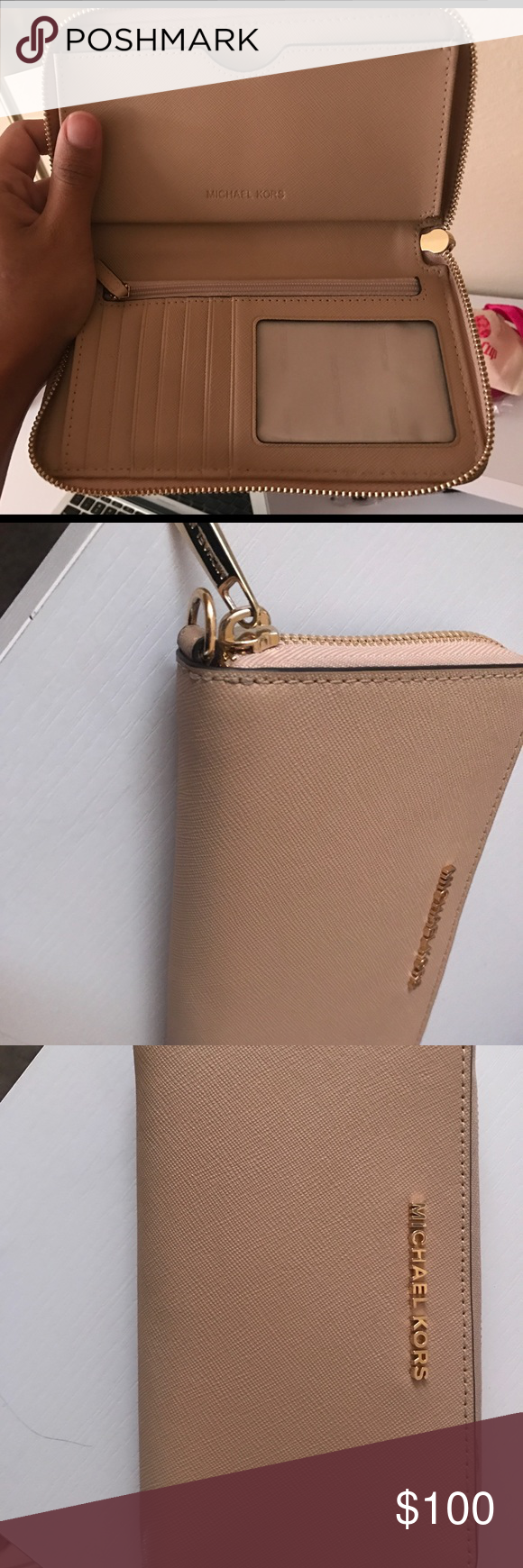 7eb7773dfbff Michael Kors wallet in the color Oyster In the color Oyster! Beautiful and  well taken care of Michael Kors Wallet. Fits iPhone 6 Plus and 7 plus.