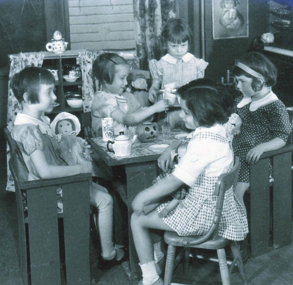 Vintage photo of a depression era little girl's Halloween tea party that include their dolls as guests!