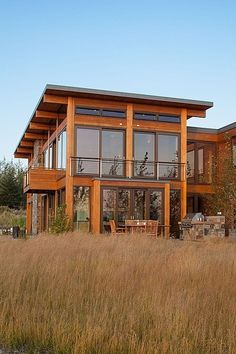 Exterior Large Windows Shed Roof Warm Wood Feels Like A Modern Prairie Style House Also Like The Field Of Flat Roof House Prairie Style Houses House Roof