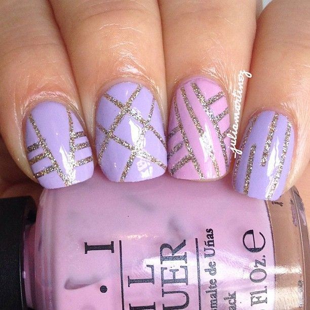 Pastel striping tape mani! colors used: #chinaglaze I'm not lion, #Sallyhansen Lacey lilac & #opi don't sparrow me the drama - @_juliamartinez