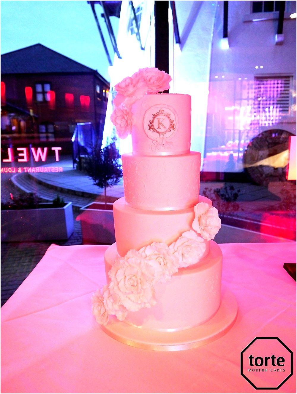 ELEGANT GLAMOUR White wedding cake with two spiralling cascades of ...