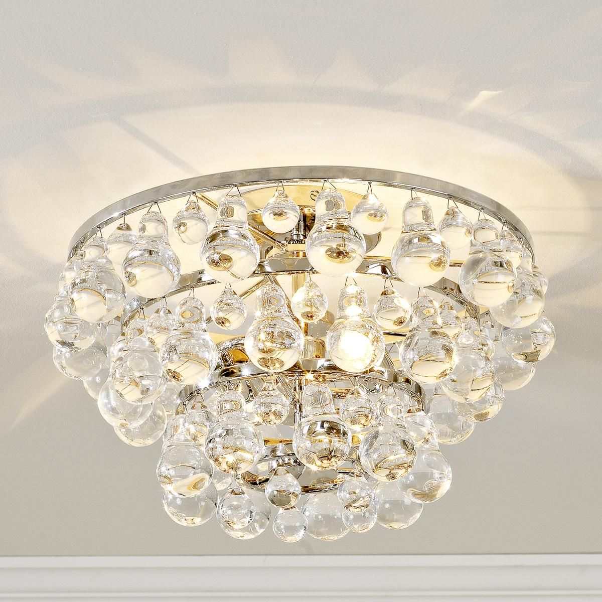 Elegance & Glamour! Pear shaped crystal balls with polished nickel.