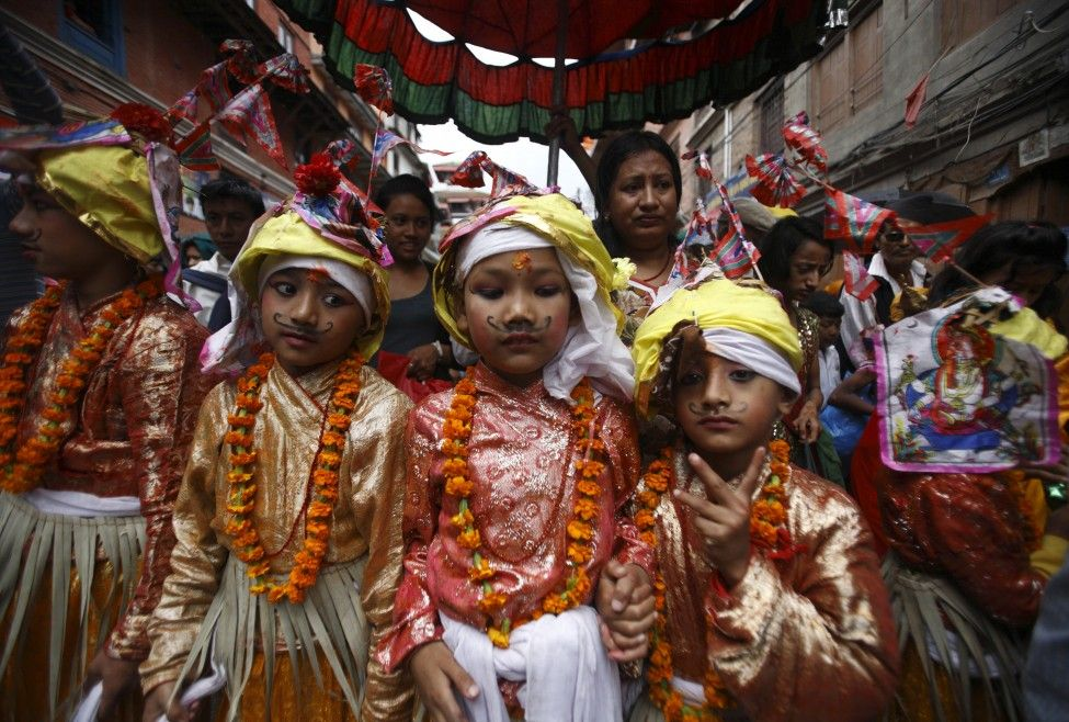 Boys dressed as holy cows participate in a parade to mark the Gaijatra Festival, also known as the festival of cows, in Kathmandu, Nepal. (Reuters)