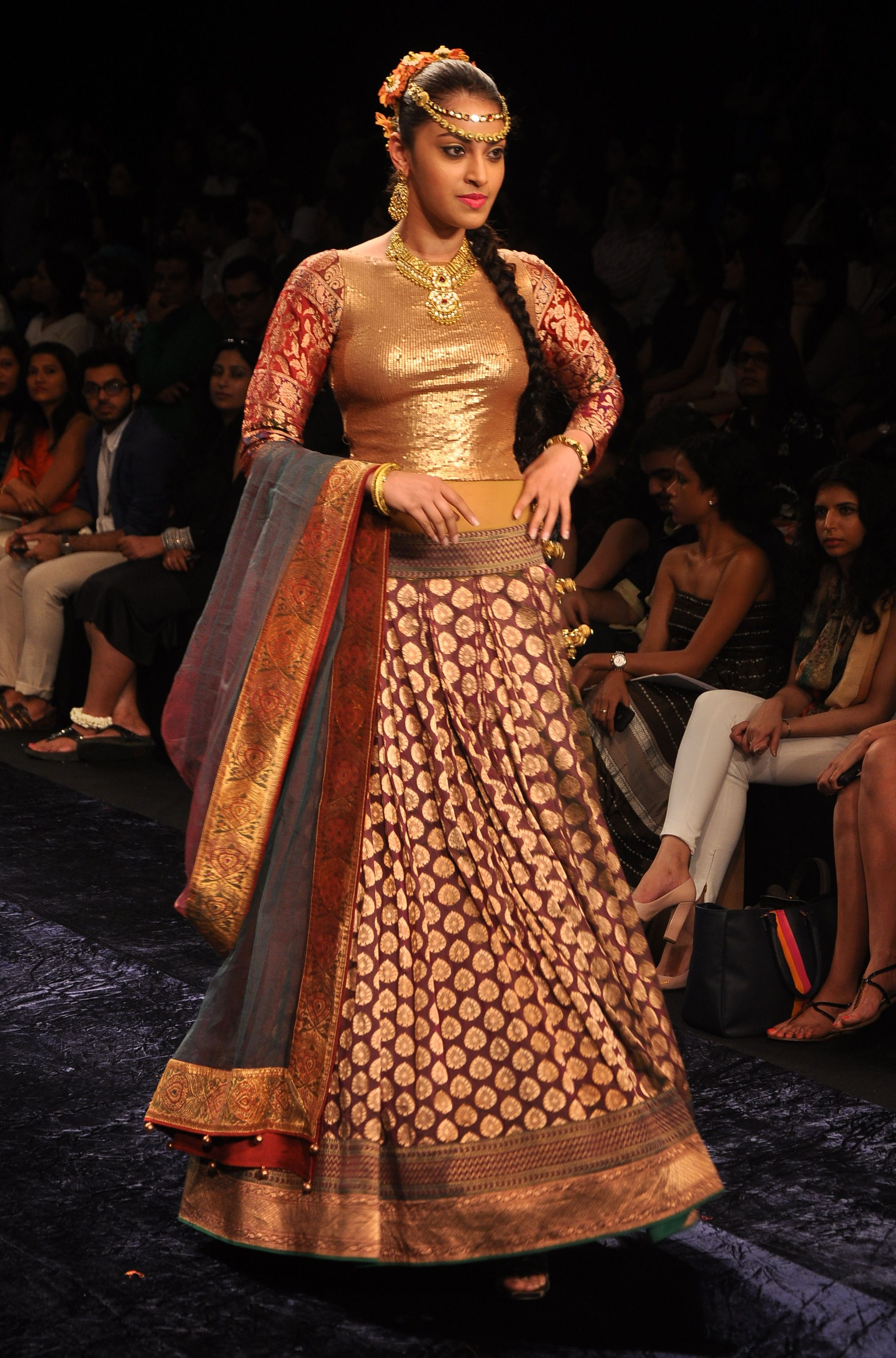 Brocade lehenga with a gold blouse and a grey dupatta.