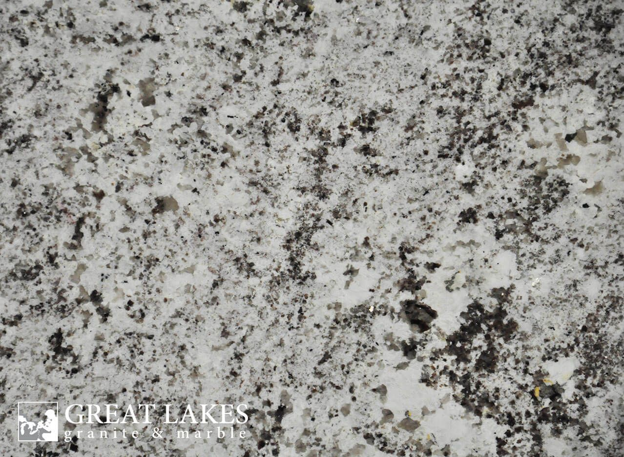 White Ice Granite From Brazil Is A Gray White Black Colored Slab With A Polished Leath White Ice Granite Black Granite Countertops White Granite Countertops