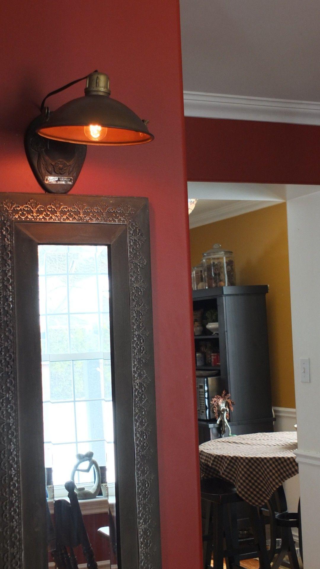 Vintage heat lamp turned wall sconce!
