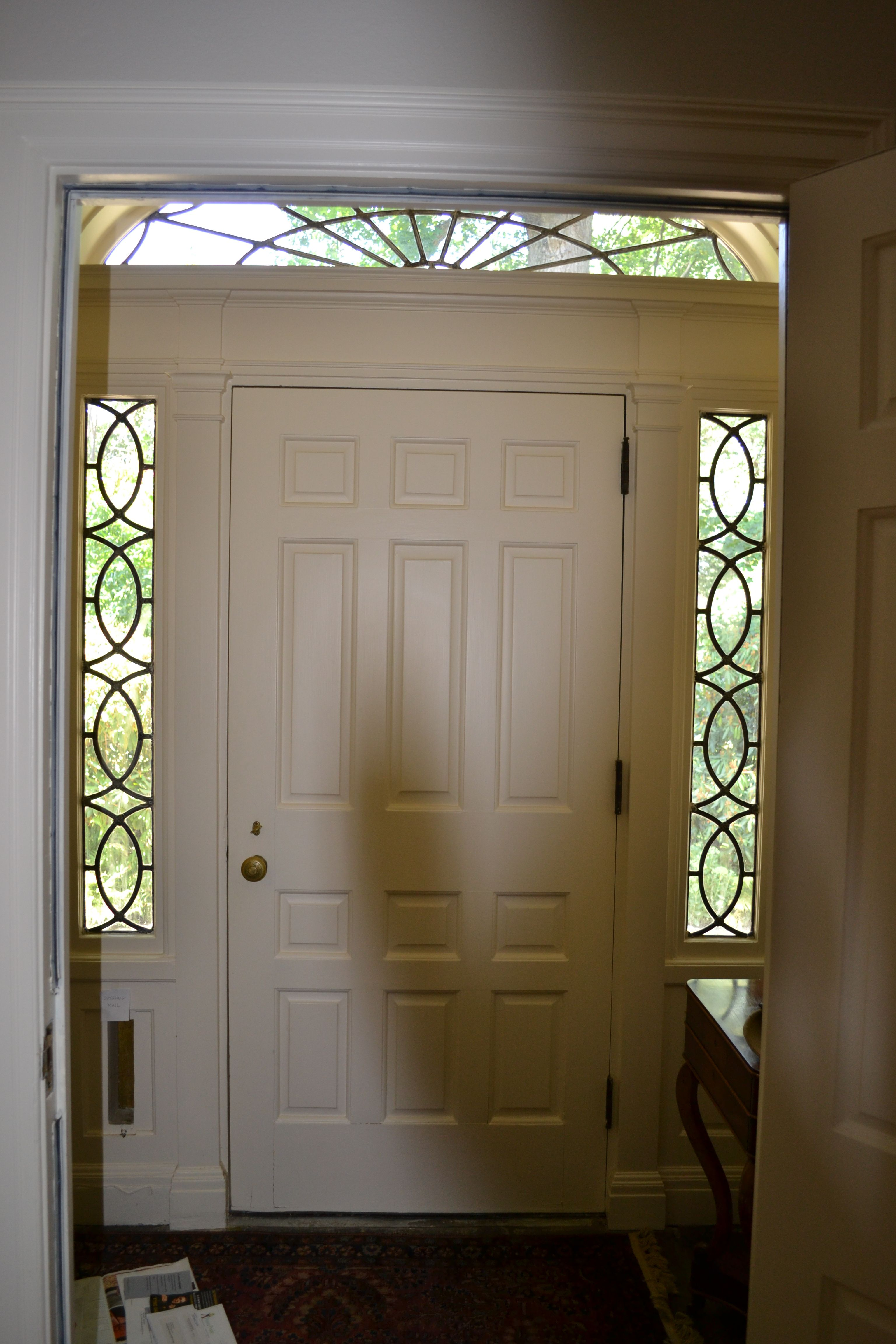 Paneled front door with 3/4 sidelights and fanlight...like the mail ...