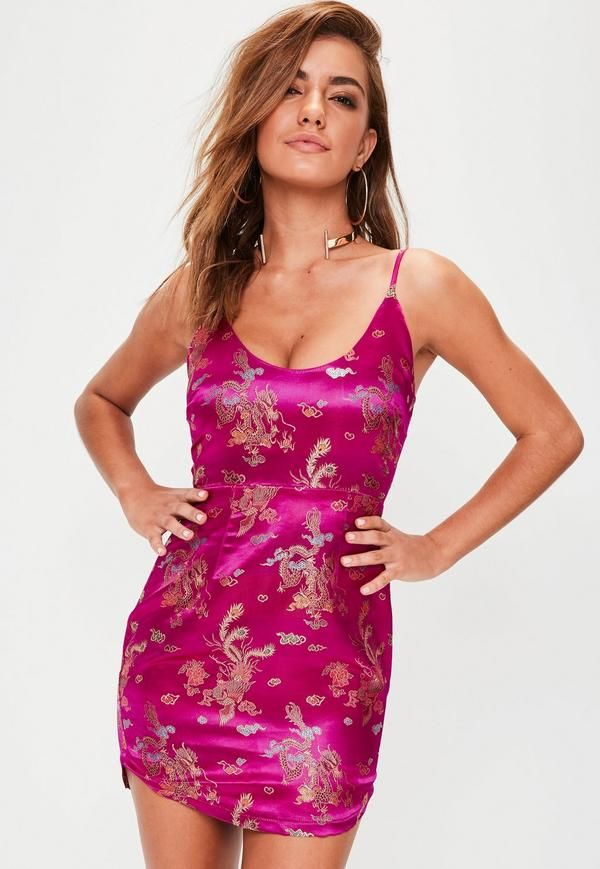 334a370d3e69 This oriental inspired beaut features a fuchsia pink hue, intricate gold  print and mini length.