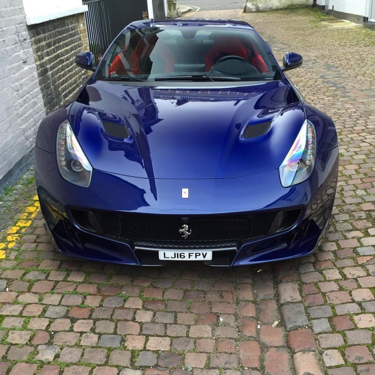 Ferrari f12 tdf painted in le mans blue photo taken by for Interieur voiture de luxe