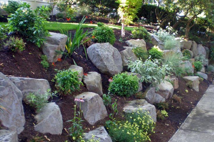 Hillside landscaping w boulders mulch Backyard Design