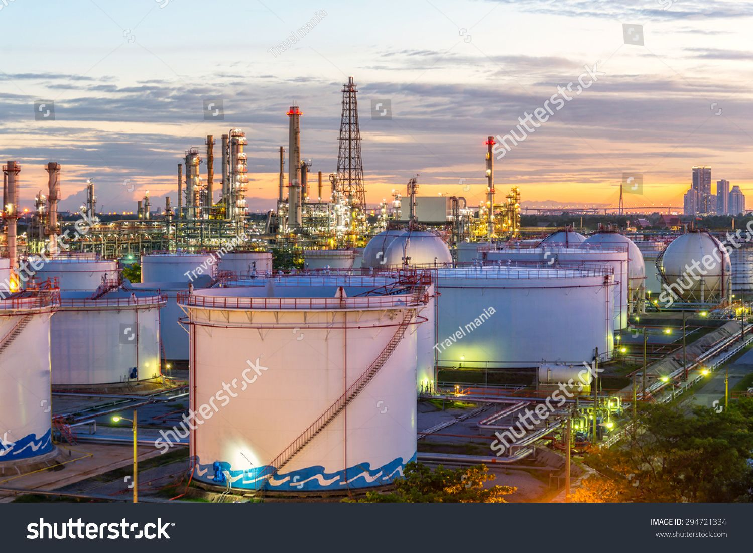 Oil and gas industry refinery at sunset factory