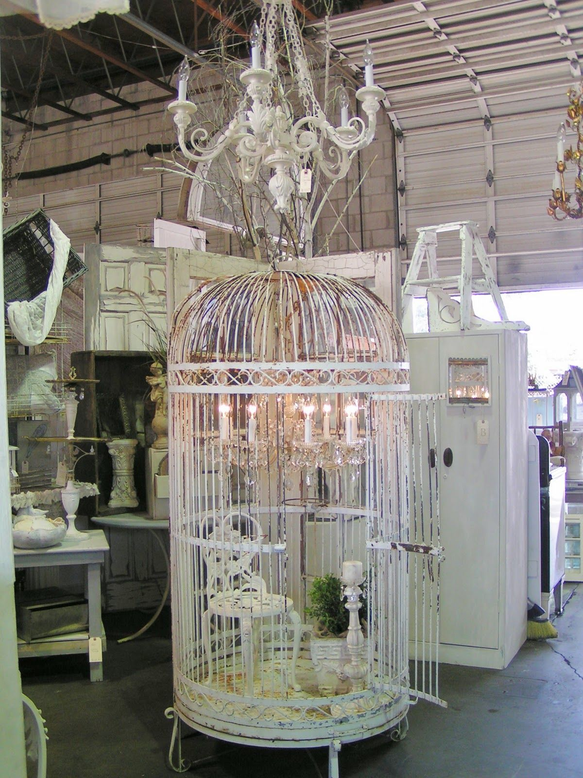 what an eye for detail Use my large bird cage Small chandelier