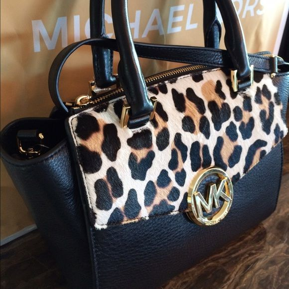 1c3a0fa58407 Michael Kors HUDSON NWT Stunning & authentic from Michael Kors. Black  leather and animal print. Logo GOLD. Medium Satchel handbag.