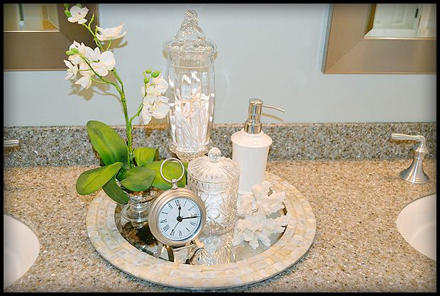 Placing a few accessories on a tray can give a bathroom for Spa like bathroom decor