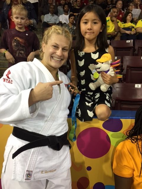 Judoka Kayla Harrison is all smiles after clinching gold in Toronto