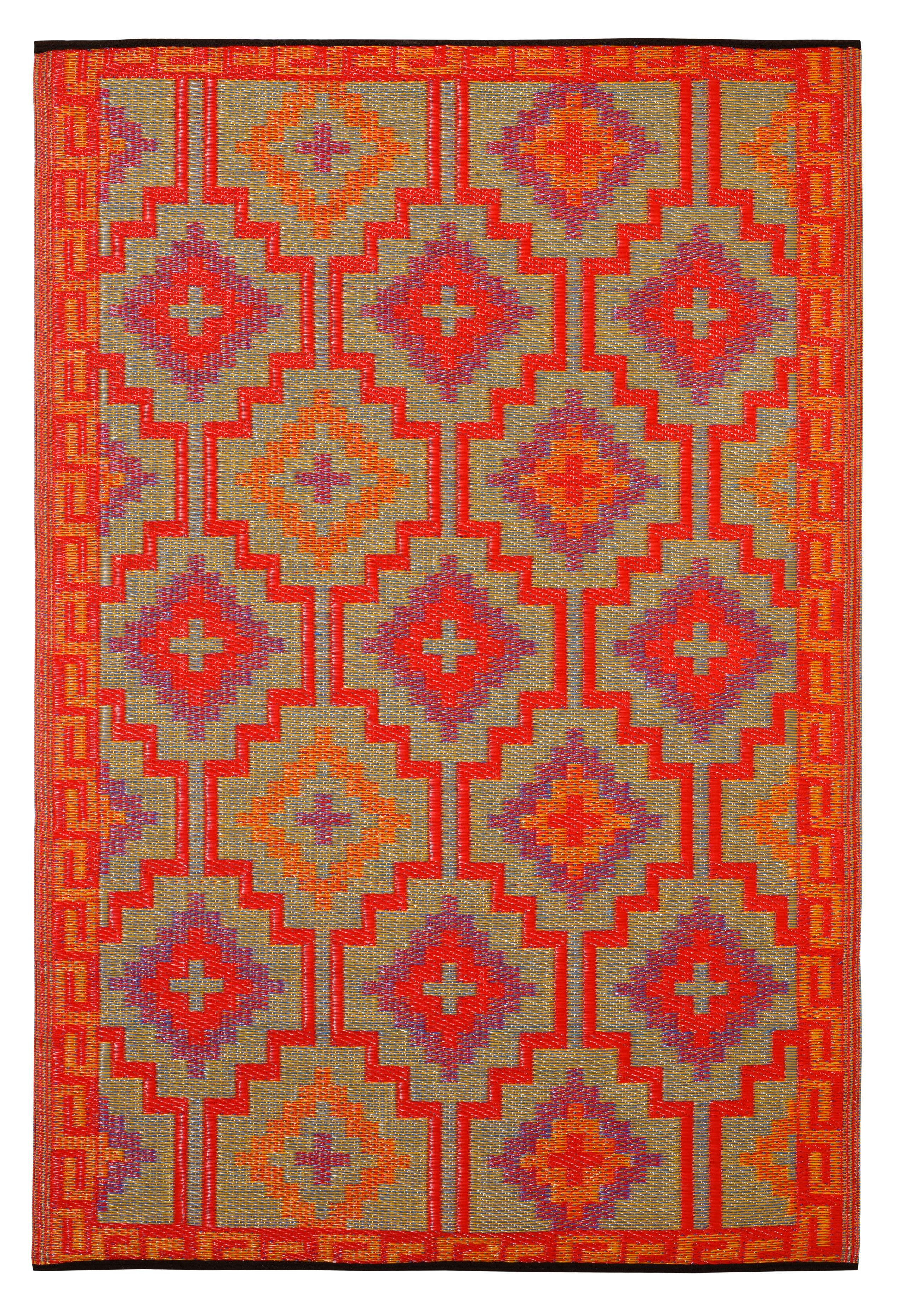 Lhasa Orage and violet outdoor/indoor rug made form recycled plastic. via Emily Henderson