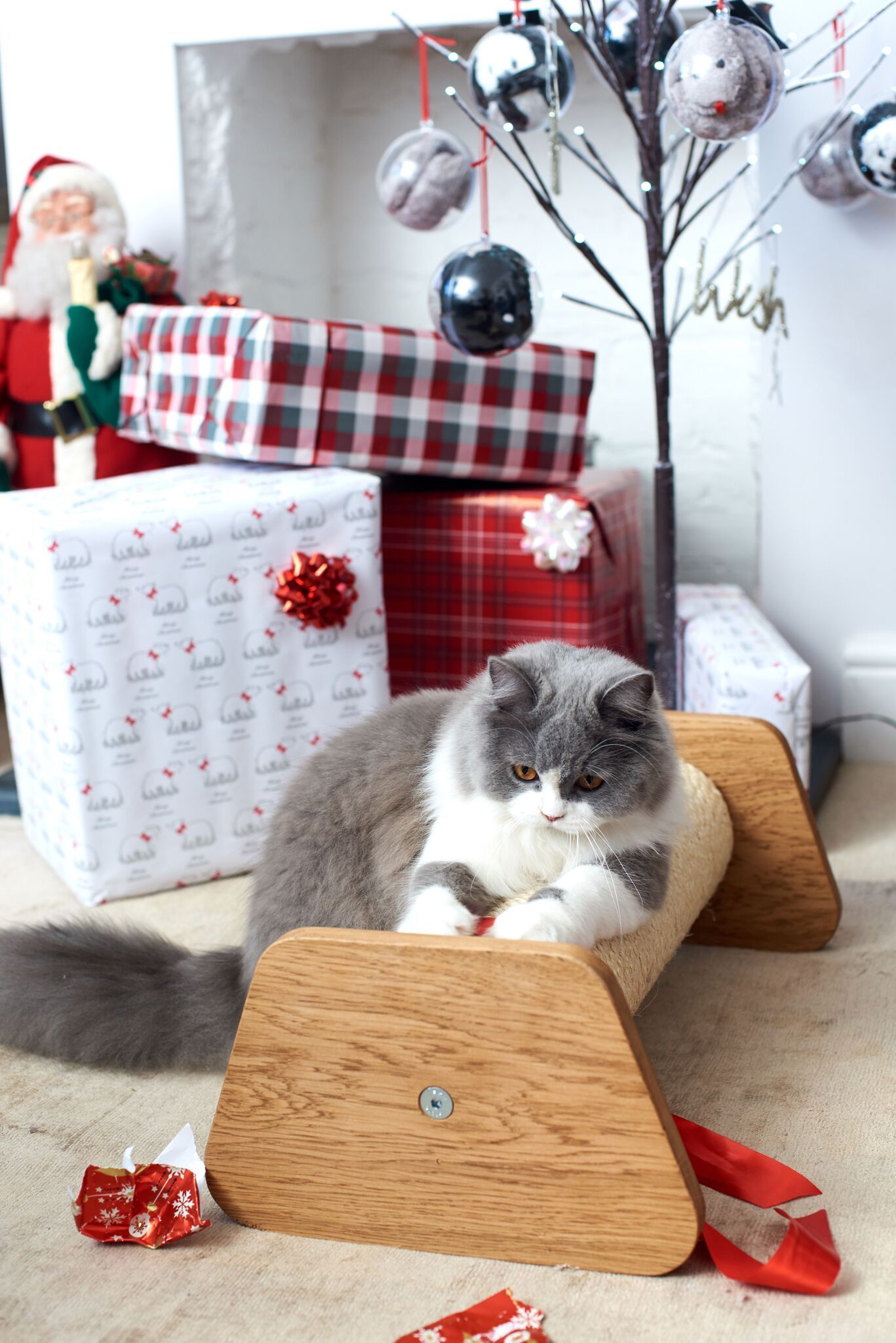 How About A Little Something For Your Cat To Open On Christmas Morning Our New Piccolo Floor Cat Scratcher Cat Scratcher Cat Tree Scratching Post Scratcher