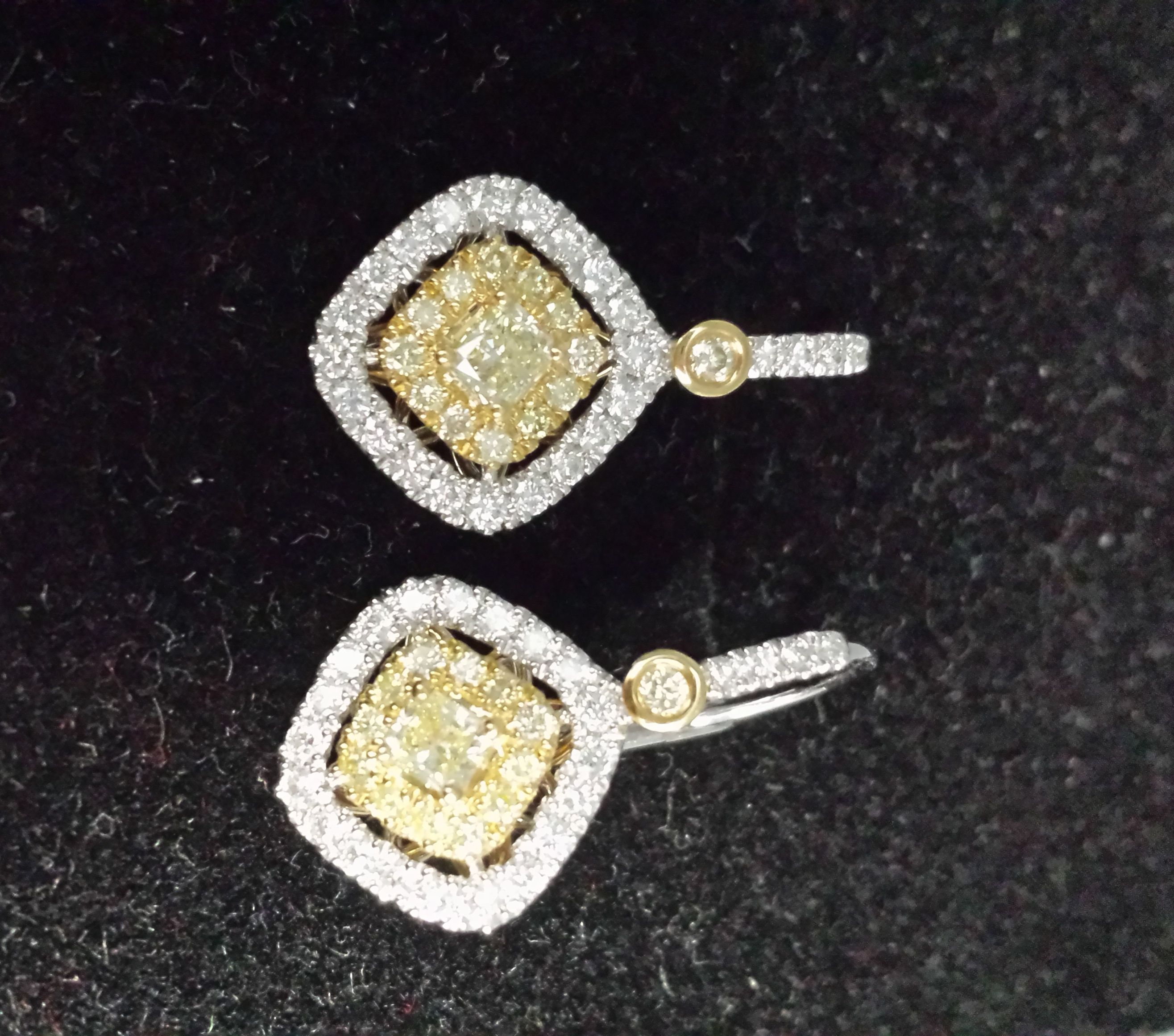 Leverback earrings in 18k with yellow diamond centers and white