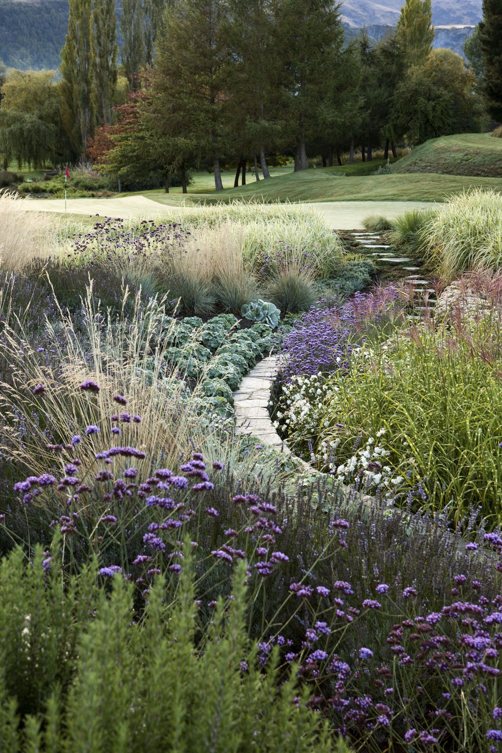 The Curve Just Adds To The Beautiful Tapestry Of Perennials Int His Landscape Garden Landscape Design Landscape Design Garden On A Hill