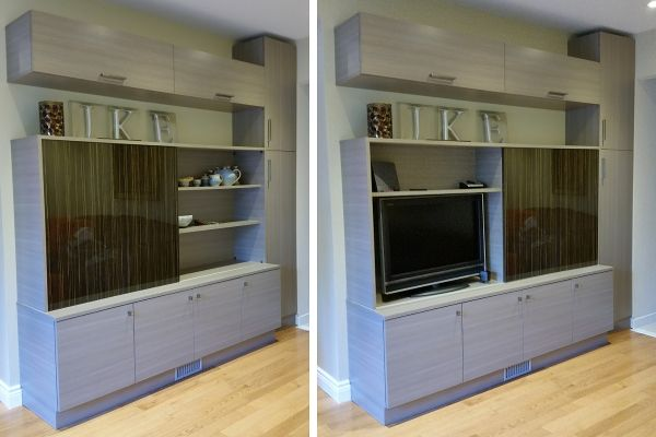 Wall unit in Aria melamine with High-Gloss woodgrain sliding door panel over TV