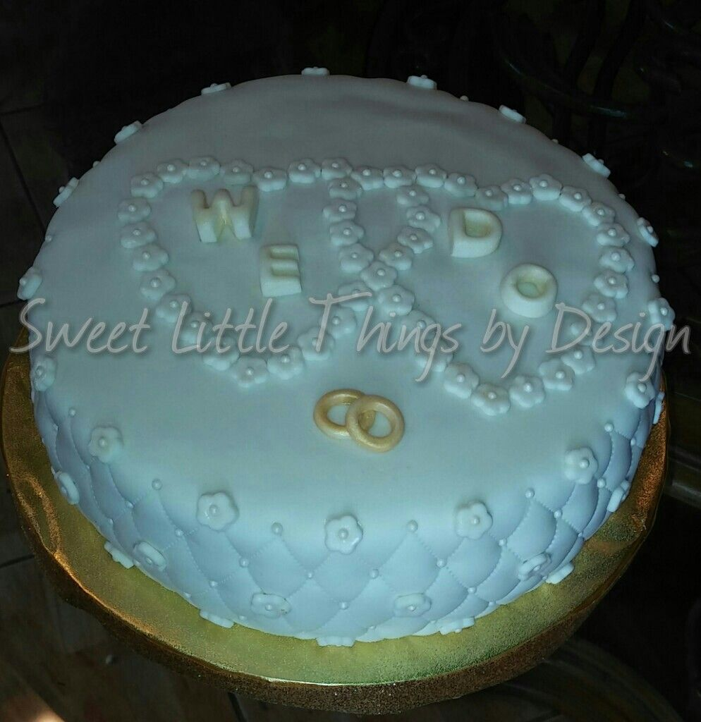 Simple wedding cake from sweet little things by design facebook