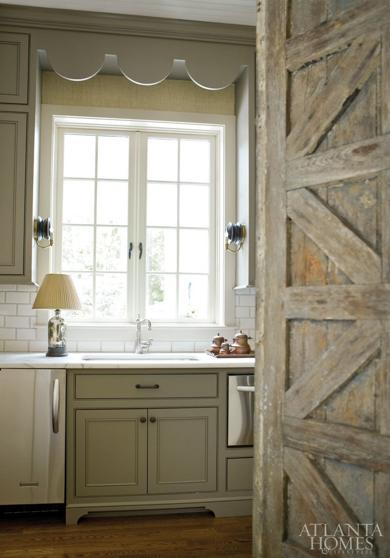 Beth Ervin - Small kitchen off of living room with door found at Linda  Horsley Antiques, green kitchen cabinets, calcutta marble countertops and  subway ... - Designed By Architect Steve McClanahan, A Scalloped Cornice Over A
