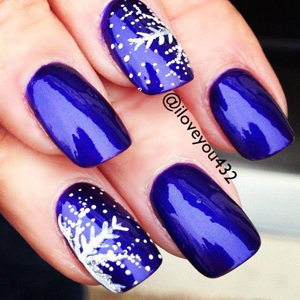 A beautiful metallic royal blue nail polish / nail art with