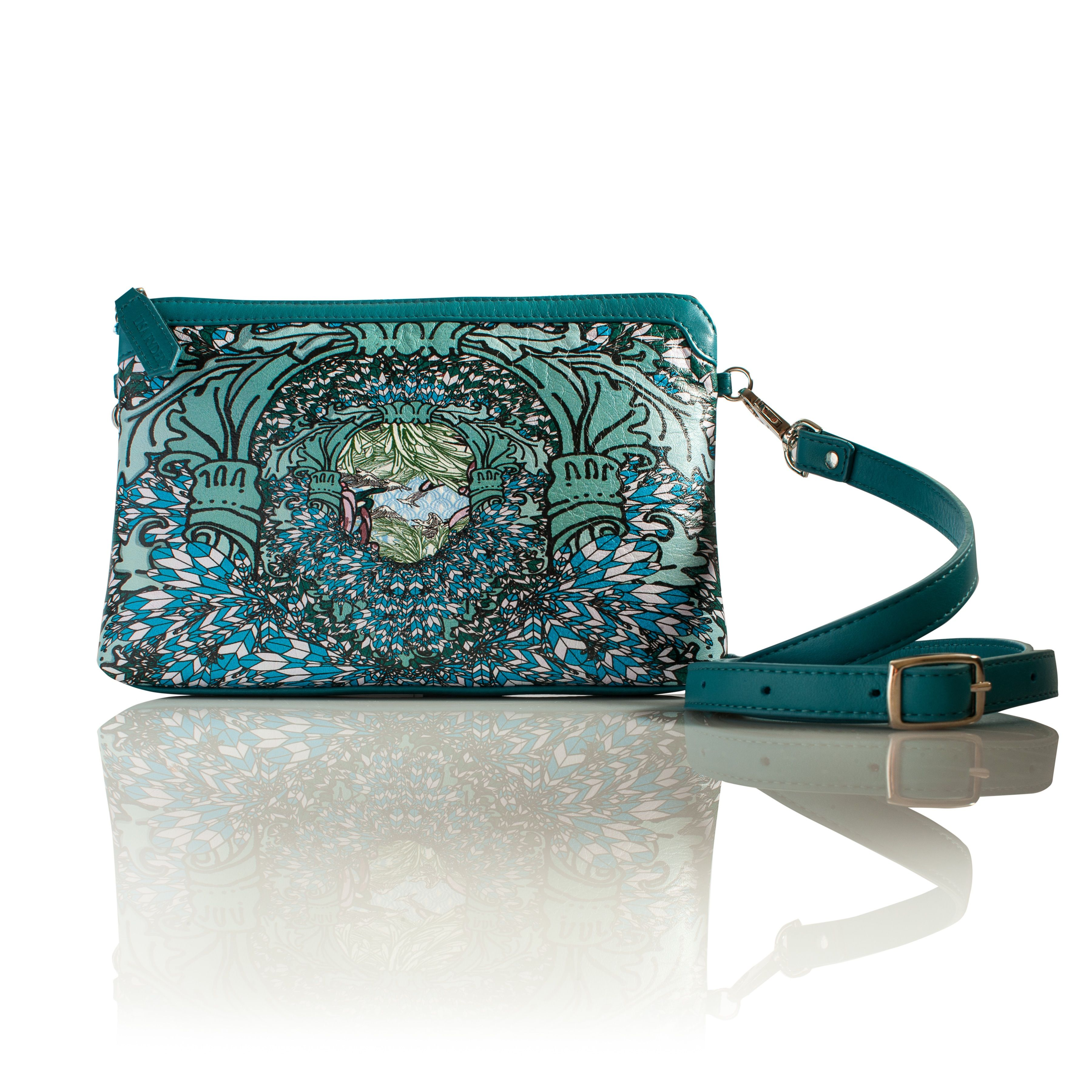 Light As A Feather (Rectangle) Cross-Body leather handbag  This print is an explosion of printed feathers. Vivid greens, turquoise blue and pastels are this bags statement colours. This is the perfect print to make a statement.    INFORMATION  Rectangular soft shoulder bag. All leather, with leather trim in soft bottle green calf skin leather. Detachable and adjustable cross strap for easy wear.  SIZE Height: 16cmcm  Width: 26cm  Strap: 114cm  Depth 3cm  www.lisaryderdesigns.ie