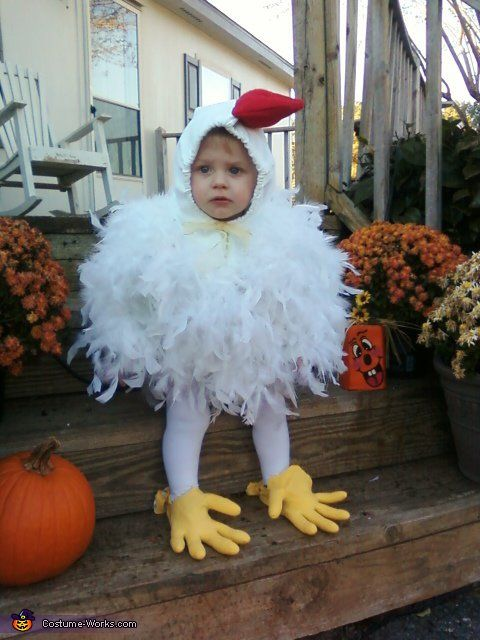 Little Kid Running In A Chicken Outfit