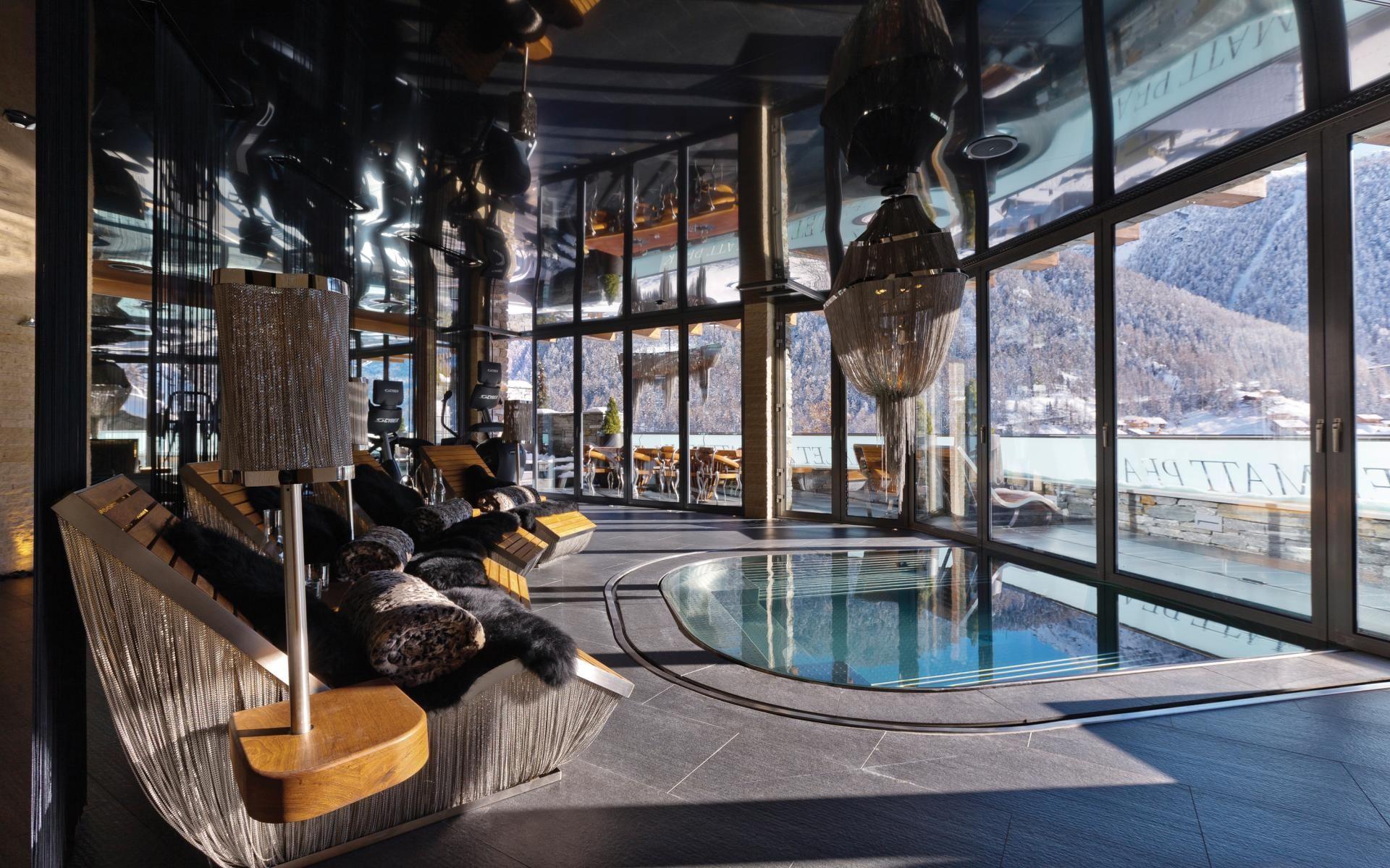 the indoor/outdoor jacuzzi pool in the spa at chalet zermatt peak