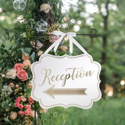 Lillian Rose This white and gold arrow sign can be positioned to point guests in the direction of the reception and is double-sided for advantageous placement. The sign is made of heavy cardstock and has a satin ribbon attached at the top for easy hanging. Measures 18