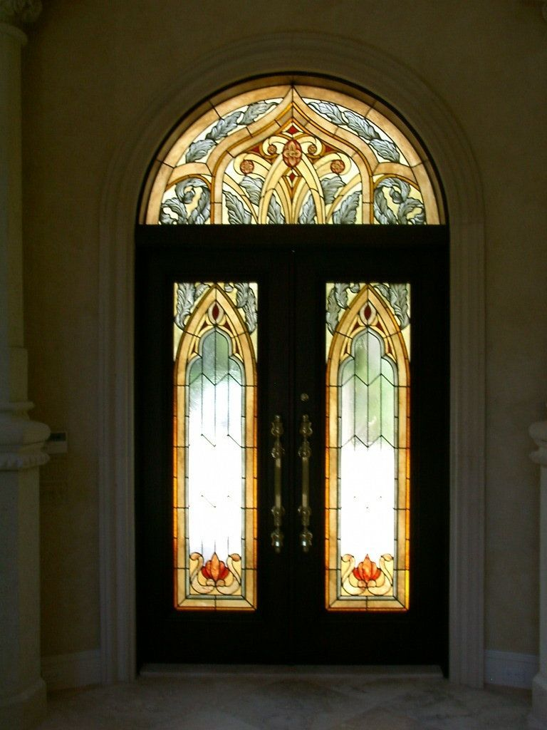 custom made stained glass entry doors and transom in a moorish