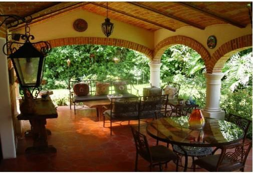 Spanish Style Patios You Ll Never Go Wrong With Wrought Iron Pieces As
