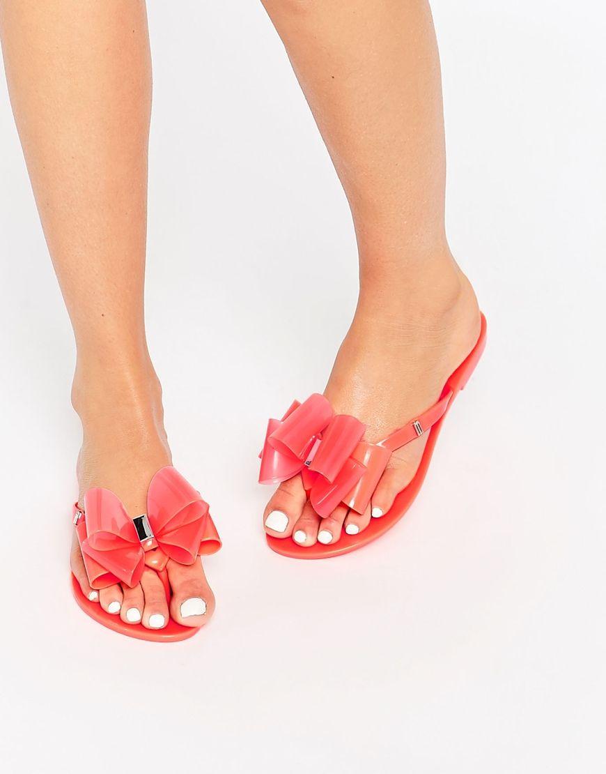 Melissa Harmonic Orange Twin Bow Flip Flops at asos.com